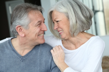 Couple happy to be retiring with a reverse mortgage.