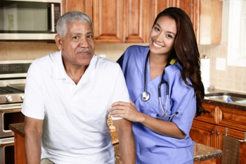 Elderly man with in home care caregiver.