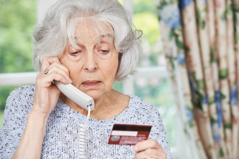 Elderly woman being scammed