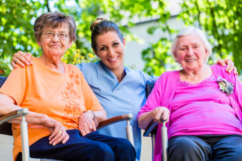 Caregiver offering companionship to elderly women