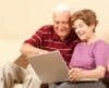 Senior couple using computer to find services