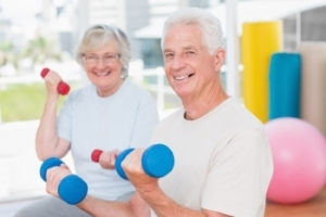 Senior man and woman exercising